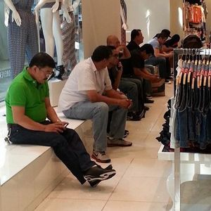 Men waiting outside dressing room - 5